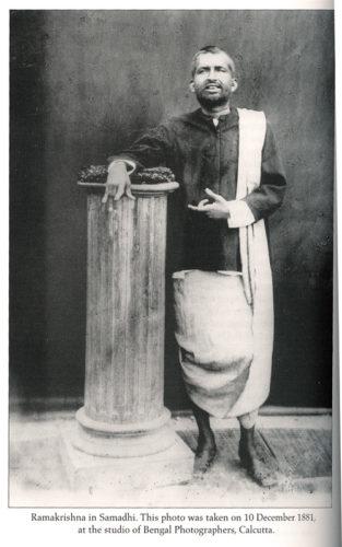 Sri Ramakrishna standing by pillar